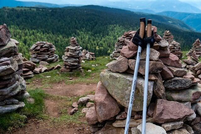 trekking poles leaned against rocks