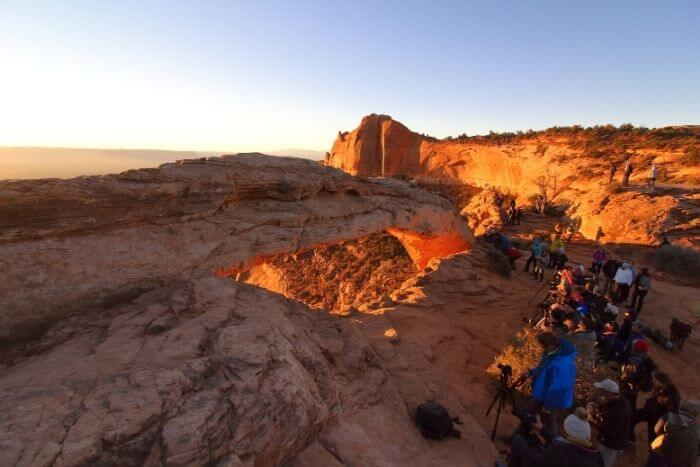 crowd of people at mesa arch